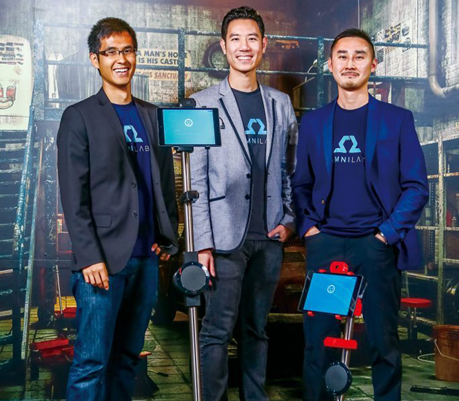 OhmniLabs Founders standing in front of an Ohmni first generation Robot. Pictured is Dr. Thuc Vu, Jared Go, and Tingxi Tan
